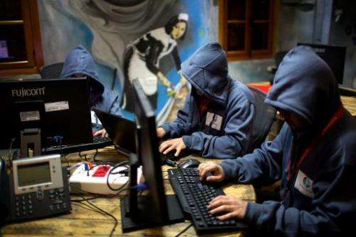 """Trainees work at the """"Cyber Gym"""" centre, where IT and infrastructure company employees train to defend against cyber a"""