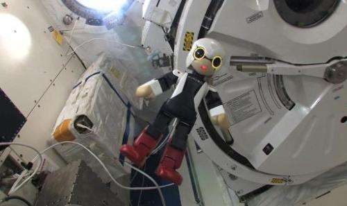 """This handout picture received from the Kibo Robot Project on November 6, 2013 shows the humanoid robot """"Kirobo"""" inside"""