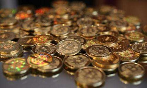 This file photo shows a pile of Bitcoins, seen after Software engineer Mike Caldwell minted them at his shop in Sandy, Utah, on