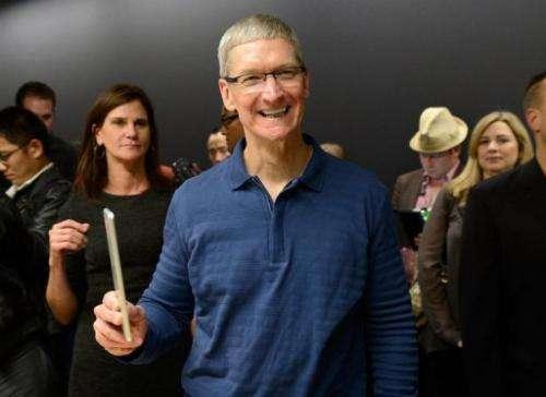 Apple CEO Tim Cook displays the new iPad mini on October 23, 2012 in San Jose, California