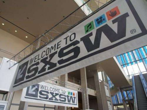Banners hang in the atrium of the Austin Convention Center on Thursday, March 7, 2013 on the eve of the opening of SXSW