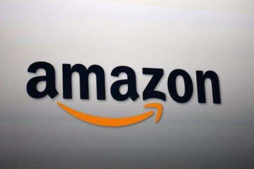 The Amazon logo is projected onto a screen at a press conference on September 6, 2012 in Santa Monica, California