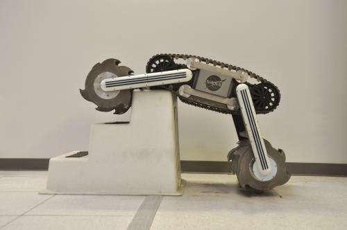 Engineers building hard-working mining robot