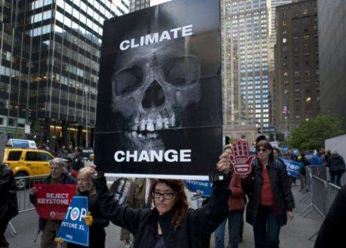 Environmental activists march in New York protesting the proposed Keystone XL pipeline, May 13, 2013