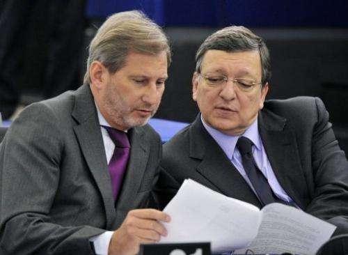 European Commission President Jose Manuel Barroso (R) and EU commissioner Johannes Hahn in Strasbourg, January 15, 2013