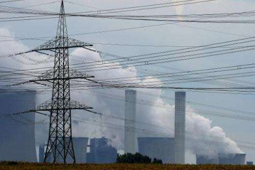 Exhaust rises from cooling towers at the Neurath lignite coal-fired power station at Grevenbroich near Aachen, southern Germany