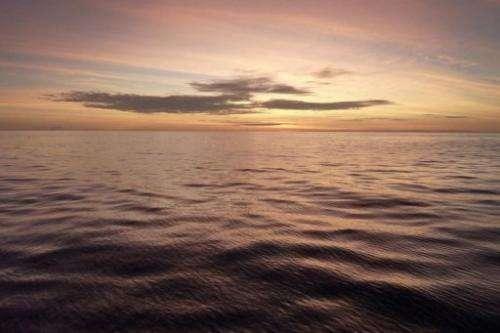 Image taken on January 27, 2011 shows the sun rising in Indonesia's Wakatobi archipelago