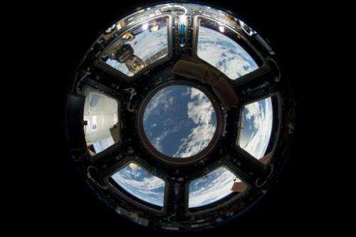 This NASA photo obtained June 18, 2013 shows a view of Earth as seen from the Cupola on the Earth-facing side of the Internation