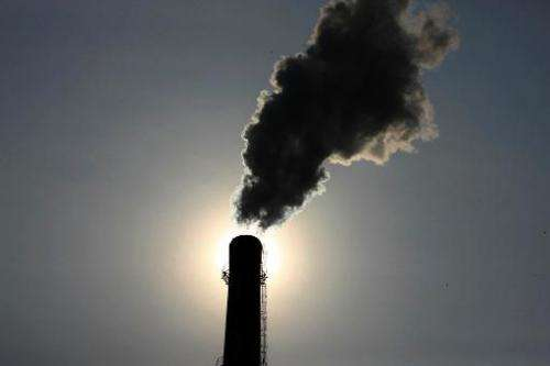 Smoke rises from a chimney at a coal chemical factory in Huaibei, east China's Anhui province on August 14, 2013