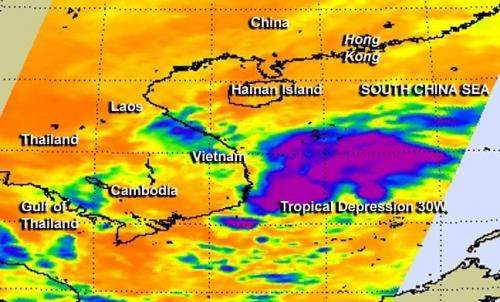 NASA sees Tropical Depression 30W stretching out, fading