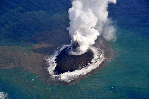 Smoke rises from a newly created islet from a volcano near the Ogasawara island chain in Japanese waters, 1,000 kilometres south