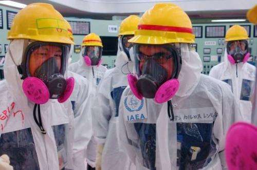 Members of the IAEA Nuclear Fuel Cycle and Waste Technology division inspect the Fukushima control room, April 17, 2013