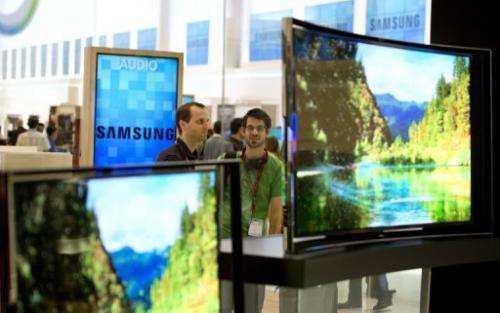 People look at curved OLED TV screens in Berlin on September 5, 2013