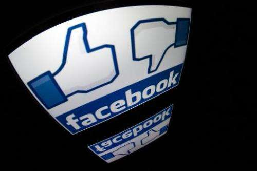 The Facebook logo is seen on a tablet screen on December 4, 2012 in Paris
