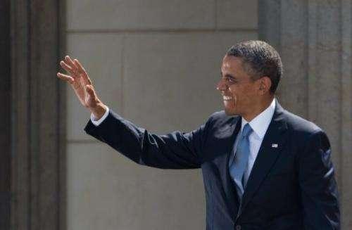 US President Barack Obama waves during his speech at the Brandenburg Gate on June 19, 2013 in Berlin