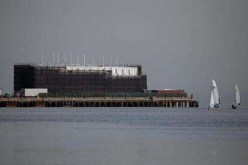 A barge under construction is docked at a pier on Treasure Island on October 30, 2013 in San Francisco, California
