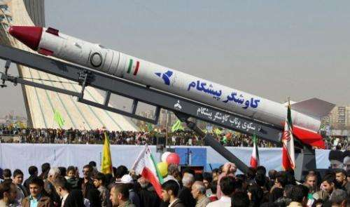 A capsule that was sent into space containing a live monkey is displayed in Tehran's Azadi Square on February 10, 2013