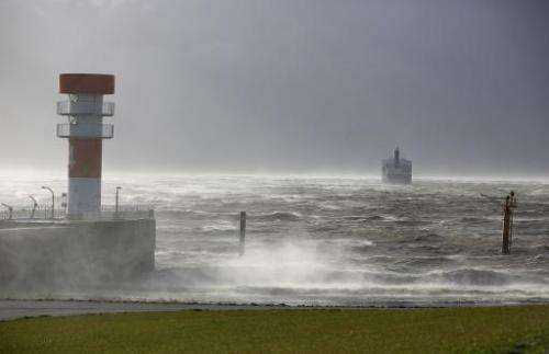 A cargo ship rides at anchor at the mouth of river Elbe into the Nordic Sea in Brunsbuettel, northern Germany as a storm dubbed