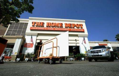 A customer pushes a cart with supplies at the Home Depot store on August 16, 2011 in the Hollywood, California