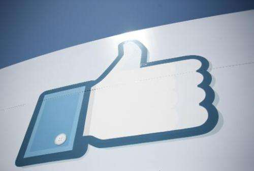 A Facebook Like Button logo is seen at the entrance of the Facebook headquarters in Menlo Park on May 10, 2012 in California