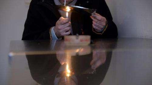 A heroin addict prepares a heroin dose on November 5, 2012 in Berlin