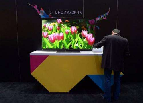 A man check out an UHD 4Kx2K TV at the TCL booth at CES on January 10, 2013 in Las Vegas, Nevada