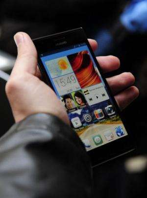 A man holds Huawei's new smartphone, Ascend P2, after a press conference in Barcelona on February 24, 2013