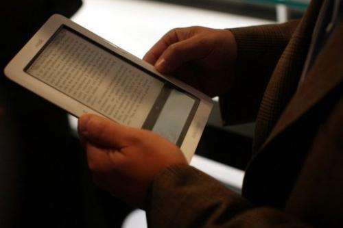 """A man reads an ebook on the """"nook"""" digital reader, October 20, 2009 in New York City"""