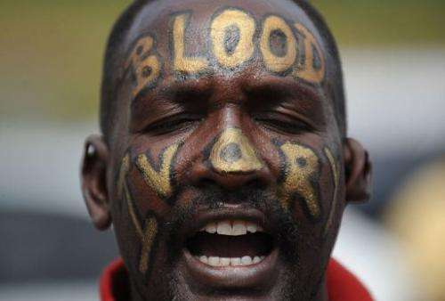 A man shouts during a protest on January 22, 2012 in Nairobi during a protest against rhino and elephant poaching