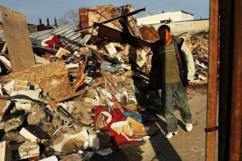 A man walks by homes and businesses destroyed by superstorm Sandy on January 2, 2013 in New York City