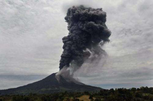 A massive ash clouds rise from the crater of the Mount Sinabung volcano during a fresh eruption on September 17, 2013