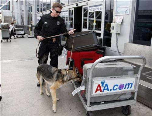 American Airlines fixes computers, delays go on