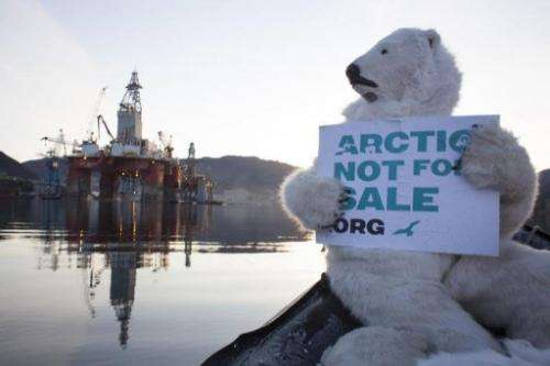 An activist dressed as a polar bear prepares to climb onto the drilling rig West Hercules, in a photo by Greenpeace