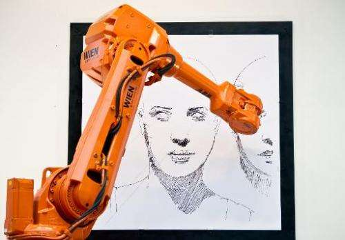 An industrial robot reproduces the art work of Austrian artist Alex Kiessling live in Breitscheidplatz in Berlin and at Trafalga