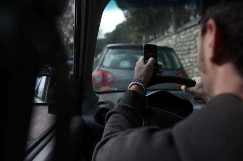 Answering messages behind the wheel is as dangerous as being twice over the limit