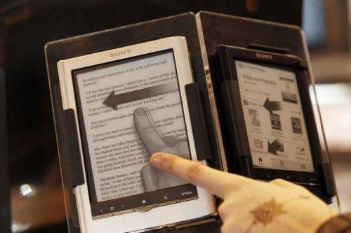 A person points at an electronic book (e-book or digital book) on March 18, 2011 in Paris