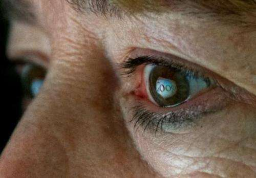 A photo showing the Internet search giant Google logo reflected in a woman's eye, June 25, 2013