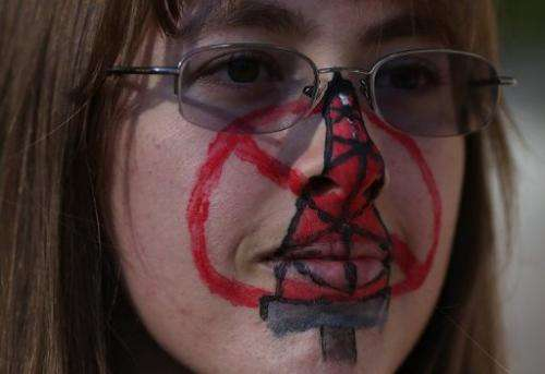 A protestor wears face paint during a demonstration against fracking on July 25, 2012 in Sacramento, California