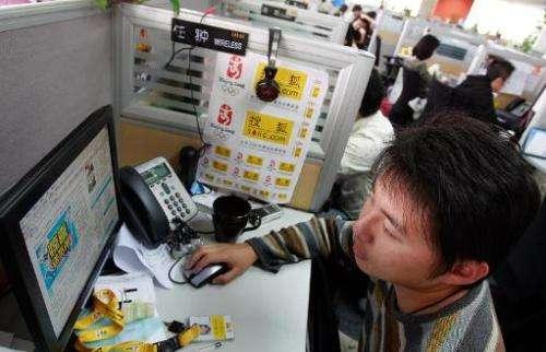 A Sohu.com employee inspects the Sohu.com website in Beijing, October 23, 2007