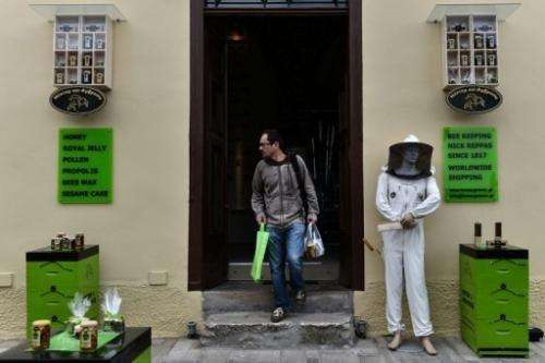A tourist leaves a honey store on April 2, 2013 in Nayplion, some 180 kilometers south of Athens