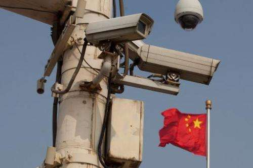 A US panel has raised the specter of sanctions against China, warning Congress that Beijing has not curbed its rampant spying on