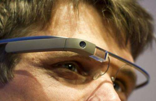 """A visitor at the """"NEXT Berlin"""" conference tries out the Google Glass on April 24, 2013"""