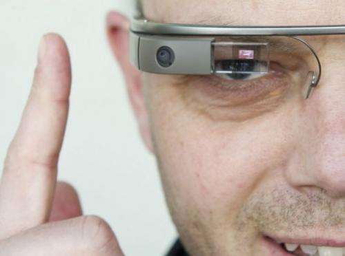 """A visitor to the """"NEXT Berlin"""" conference tries out Google Glass on April 24, 2013 in Berlin"""