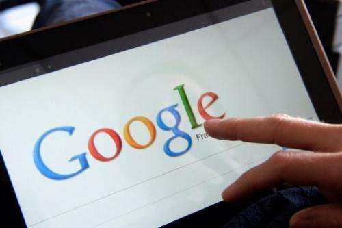 A woman chooses Google Search on her tablet on May 13, 2013 in the French western city of Rennes