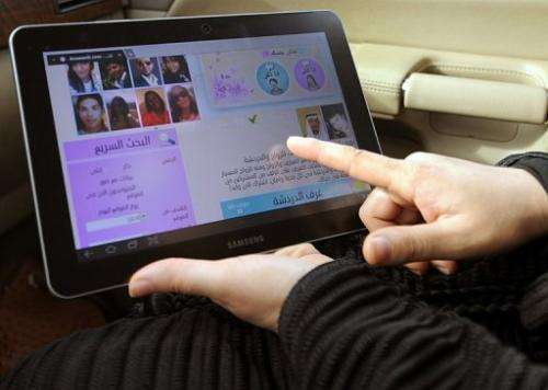 A woman looks at a tablet computer in Riyadh on February 4, 2013