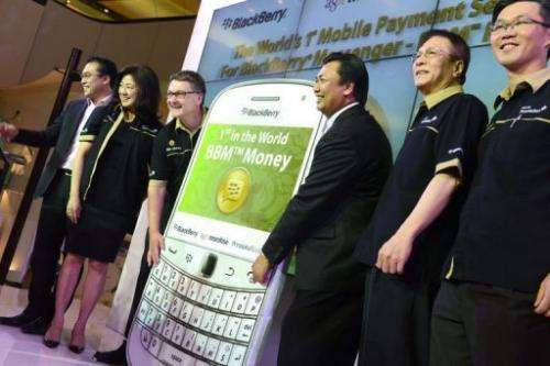 Bank Permata and Blackberry Indonesia launch an instant messaging banking service in Jakarta on February 26, 2013