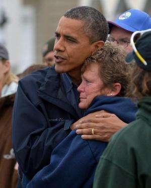 Barack Obama comforts a Hurricane Sandy victim as he visits New Jersey on October 31, 2012