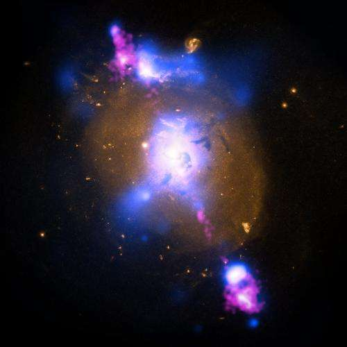 Black hole powered jets plow into galaxy