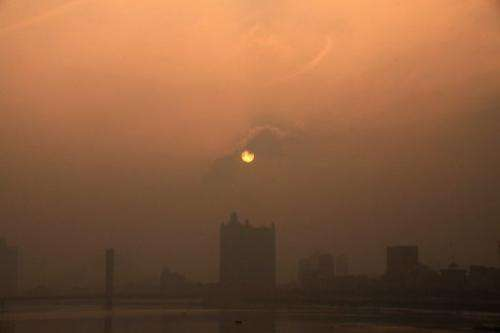 Buildings are seen through heavy smog in Jilin, northeast China, on January 29, 2013