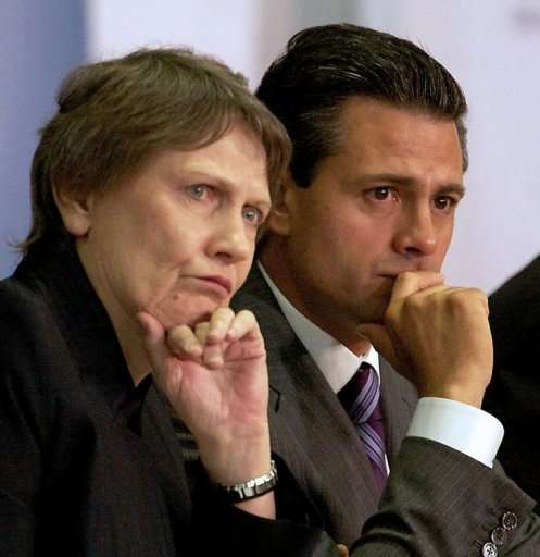 Enrique Pena Nieto and Helen Clark, listen to the presentation of the 2013 development report on March 14, 2013, Mexico